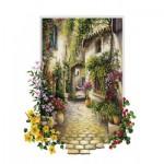 Art-Puzzle-4189 Jolie Ruelle d'un Petit Village Fleuri