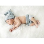 Grafika-01617 Konrad Bak: Baby sleeping in Feathers