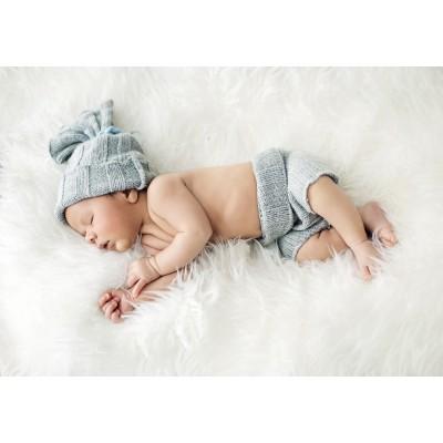 Grafika-01618 Konrad Bak: Baby sleeping in Feathers