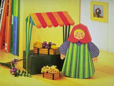 maquette-en-carton-femme-de-marche-avec-etal-de-vente